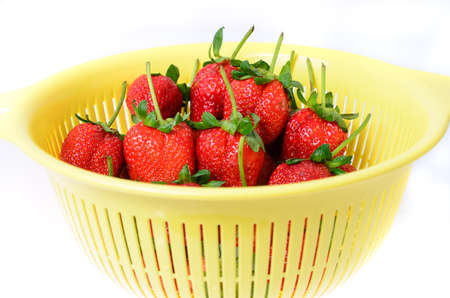 red strawberries in basket isolated on white