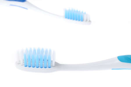 New toothbrush on white background and blur old toothbrush Banco de Imagens