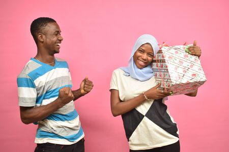 guy feeling excited with girlfriend after giving her a present