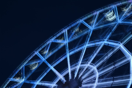Defocused ferris wheel with colorful lights, Blur abstract background. amusement Park at night