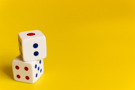 white dice on a yellow background different values of numbers