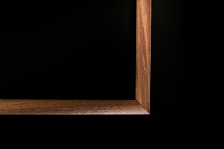 black background wooden brown frame. abstraction the angle of the diagonal cut portion.