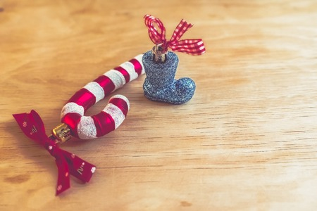 Christmas toy boot and candy cane wooden background.new year 2019