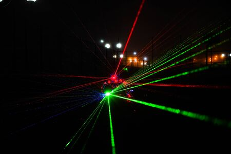 multi-colored laser beams. man laserboy. laser lines in the dark