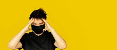 girl brunette short hair black medical mask holding her head with her hands emotion nervous banner yellow background 스톡 콘텐츠
