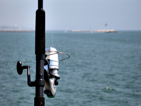 close up shot of fishing rod against blue water