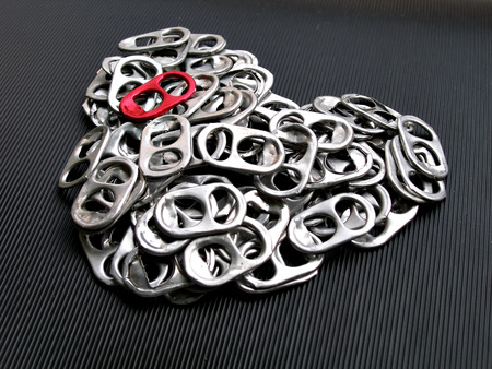 close up shot of pull tabs of soda can arranged in heart shaped