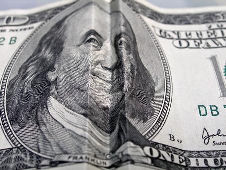 close up of folded hundred dollar bill