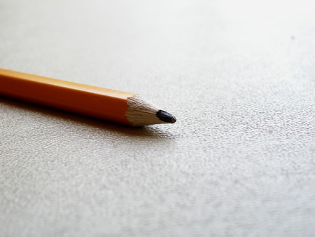 close up shot of pencil on plastic table
