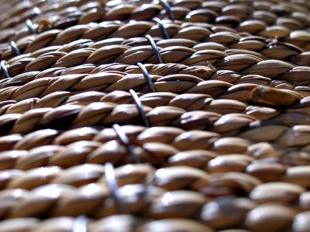 close up shot of braided straw of basket Imagens