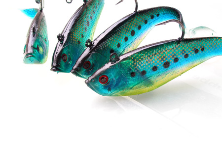 close up shot of green fish lures with sharp hooks