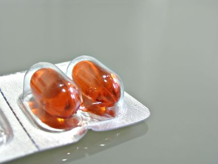 Close of orange medicine capsules