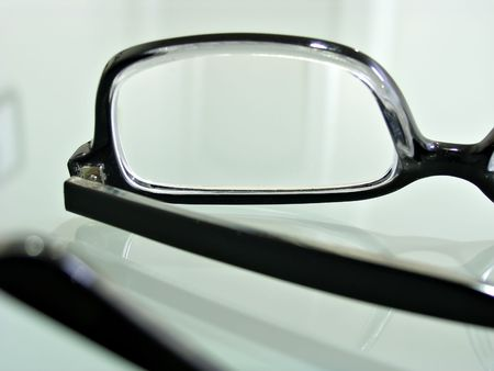 Close up shot of dark-rimmed eye glasses   Imagens