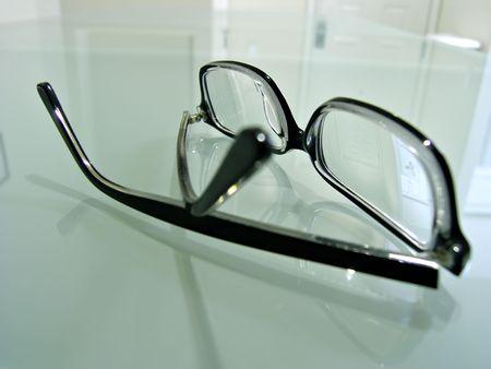 Close up shot of dark-rimmed eye glasses   Фото со стока