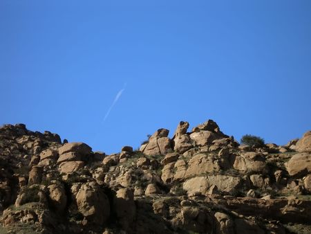 rocky cliff against clear blue sky