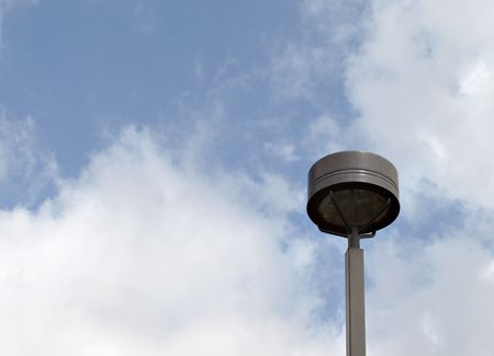 brown metal lamp post against blue sky