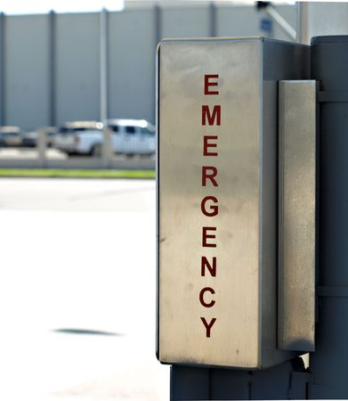 Emergency sign on stainless metal Imagens