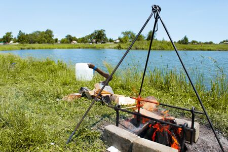 picnic by the lake bonfire barbecue axe