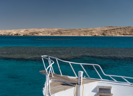 View at clear sea with blue water from a white yacht