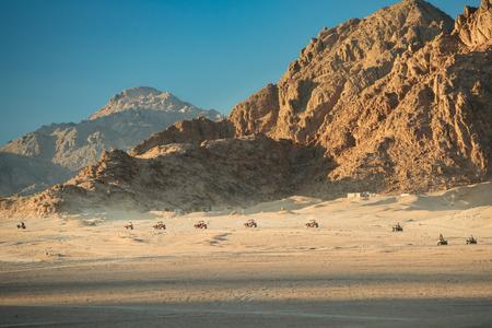 Extreme entertainment in the desert on 4-wheelers. Rally in desert of Sinai peninsula Stock Photo