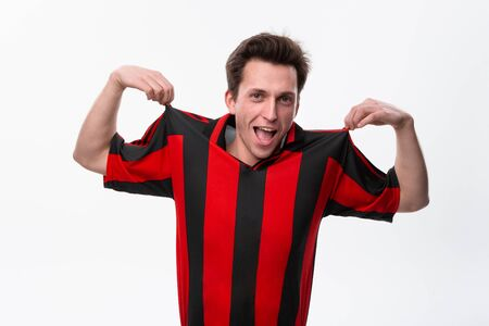 Excited soccer player in a red sportswear isolated over white background. Sportswear for soccer Stock Photo