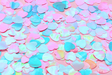 Beautiful holographic neon hearts. Trendy colors pink and blue. Colorful festive Valentines Day background. Love. Backdrop for text. 版權商用圖片