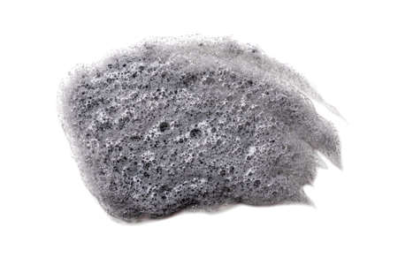 Gray smear of Korean bubble mask on white background isolated. Acne treatment, cosmetology, dermatology. Beauty product. Black clay smudged. Skin care, organic cosmetics. Carbonic acid. Closeup. 写真素材