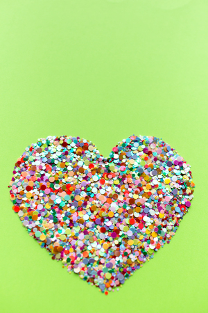 Valentine hearts on ufo green background. Valentine's day concept. Confetti hearts. Stock Photo