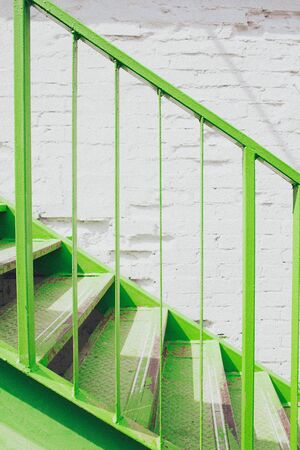 Green metal stairs. Trending color. Minimalism concept