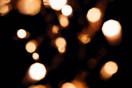 Golden abstract bokeh sparkle on black isolated background. Holiday concept. Place for design. Festive concept.