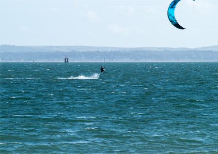 Airborne whilst windsurfing Stock Photo