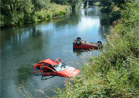 Over-flow car park, Vehicles abandoned in river.