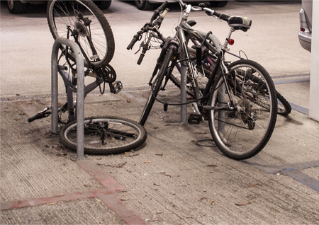 cycles: Pedal cycles left secure in car parking area.