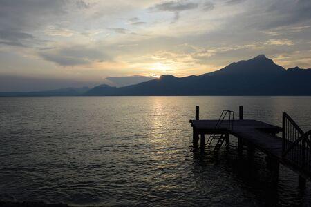 Sunset dropped over the mountain range of Lake Garda, Italy
