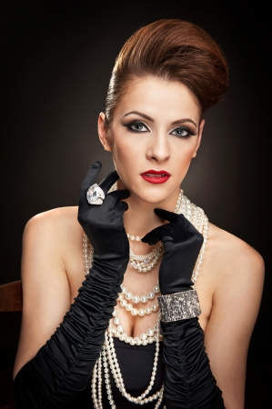 costume jewelry: portrait of beautiful woman with beads and gloves