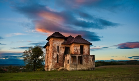 devastation: Old abandoned haunted house and sky in Transylvania with clouds Abandoned mansion in ruins