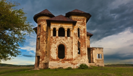 ravaged: Old abandoned haunted house and sky in Transylvania with clouds Abandoned mansion in ruins