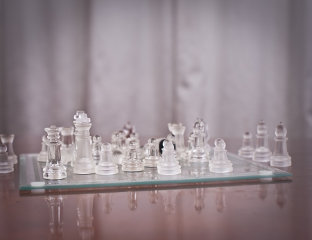 pieces on the chessboard Set of chess figures on the playing board  Glass Chess photo