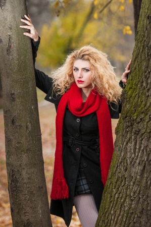 Attractive young woman in a autumn fashion shoot  . photo
