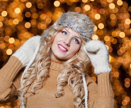 Fashionable lady  wearing cap and muffler coat outdoor  Portrait of young beautiful woman in winter  Reklamní fotografie