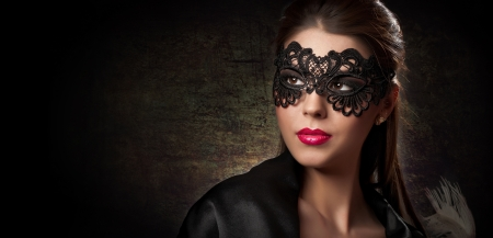 Portrait of attractive sensual young woman with mask photo
