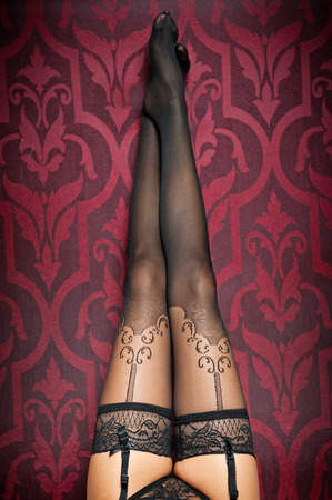 stockings feet: Long legs in black stockings and panties indoor shot  Sexy woman legs