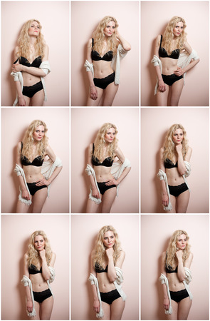 Attractive sexy blonde in black lingerie posing provocatively indoor. Portrait of sensual woman wearing black lingerie in classic boudoir scene. Woman with long hair and sweater against a wall photo