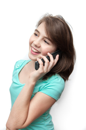 express positivity: Attractive teenage girl talking on the phone. All on white background.