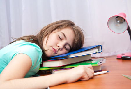wearied: bored and tired student after hard work. Back to school concept Stock Photo