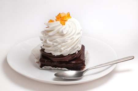 custard slices: Piece of chocolate cake with cream on a white plate Stock Photo