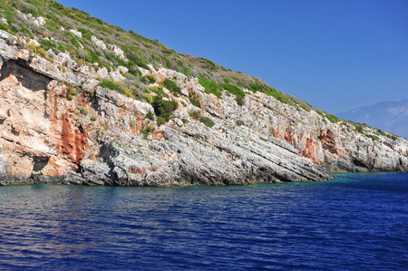 ionian island: Island in the Ionian Sea, Zakynthos. Azure coast of Greece. View of coast from the sea. Stock Photo