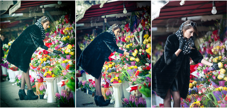 25 30 years women: Beautiful brunette woman with gloves choosing flowers at the florist shop. Fashionable female with sunglasses and head scarf at flower shop. Pretty brunette in black choosing flowers - urban shot