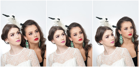 Hairstyle and make up - beautiful females art portrait. Elegance. Genuine natural brunettes with accessories in studio. Portrait of two attractive women with creative makeup photo