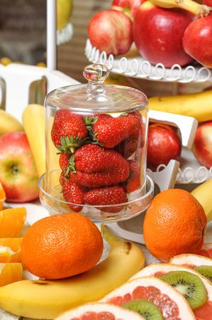provision: Carved fruits arrangement. Fresh various fruits. Assortment of exotic fruits. Fresh fruits decoration